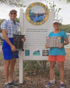 Randy and Bonnie Radke of the Coronado/Mainland Shuffleboard Club show their trophies and plaques they earned during the 2016 tournaments.