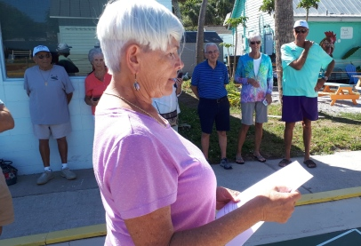 Barb Fortini reads oath of office to Dennis and Tom